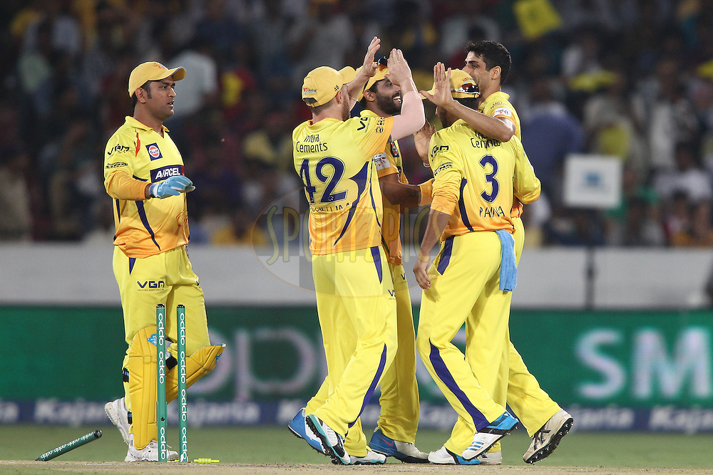 Ashish Nehra of the Chennai Super Kings is congratulated for bowling Wriddhiman Saha of the Kings XI Punjab during the second semi final match of the Oppo Champions League Twenty20 between the Kings XI Punjab and the Chennai Superkings held at the Rajiv Gandhi Cricket Stadium, Hyderabad, India on the 2nd October 2014<br /> <br /> Photo by:  Shaun Roy / Sportzpics/ CLT20<br /> <br /> <br /> Image use is subject to the terms and conditions as laid out by the BCCI/ CLT20.  The terms and conditions can be downloaded here:<br /> <br /> http://sportzpics.photoshelter.com/gallery/CLT20-Image-Terms-and-Conditions-2014/G0000IfNJn535VPU/C0000QhhKadWcjYs