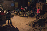 Dongsanqi, Changping District, Beijing. Many of the older shacks and single floor buildings in Dongsanqi are being demolished to make way for new, cheap apartments. Work often goes on for 24 hours a day in this economically depressed but vibrant community, enlivened by the hard work and good humour of immigrant labourers.