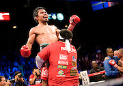 Manny Pacquiao of the Philippines celebrates after defeating Miguel Angel Cotto of Puerto Rico in their WBO Welterweight Championship fight at the MGM Grand Garden Arena on November 14, 2009 in Las Vegas, Nevada. Pacquiao has now won seven world titles in as many divisions