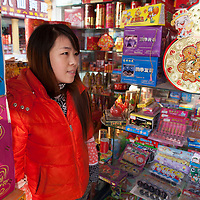 """Hunan, Liuyang, Dec. 19..2013 :  Yang Li, who works in her father- in -law's firecracker retail store in the """"Liuyang  interational firecrackers exhibition and trade city """" , during an interview ."""