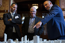 © Licensed to London News Pictures . 28/07/2016 . Manchester , UK . RYAN GIGGS (l) and architects look at a proposed model of the site . Launch of the St Michael's city centre development , at the Lord Mayor's Parlour in Manchester Town Hall . Backed by The Jackson's Row Development Partnership (comprising Gary Neville , Ryan Giggs and Brendan Flood ) along with Manchester City Council , Rowsley Ltd and Beijing Construction and Engineering Group International , the Jackson's Row area of the city centre will be redeveloped with a design proposed by Make Architects . Photo credit : Joel Goodman/LNP