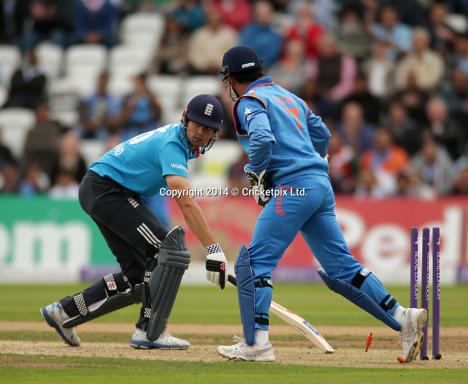 Alastair Cook is stumped by wicket keeper Mahendra Singh Dhoni during the third Royal London One Day International between England and India at Trent Bridge, Nottingham. Photo: Graham Morris/www.cricketpix.com (Tel: +44 (0)20 8969 4192; Email: graham@cricketpix.com) 300814