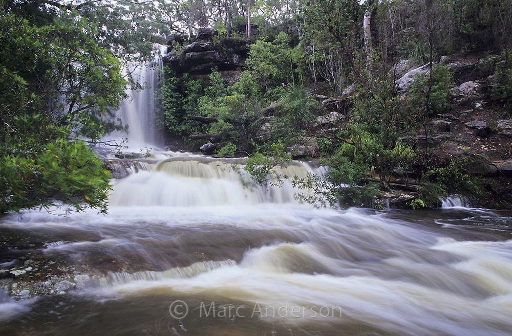 A waterfall and a fast flowing river, Upper National Falls, Royal National Park, Australia.