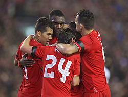 LIVERPOOL, ENGLAND - Thursday, November 26, 2015: Liverpool's Christian Benteke celebrates scoring the second goal against FC Girondins de Bordeaux with team-mates Roberto Firmino, Joe Allen and James Milner during the UEFA Europa League Group Stage Group B match at Anfield. (Pic by David Rawcliffe/Propaganda)