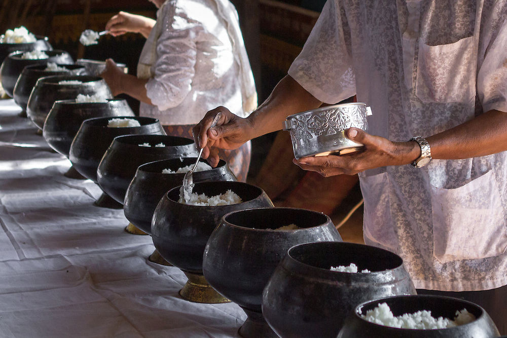 People offer rice at a local monastery in Kompong Cham, Cambodia, during Virak Wanabat, the second day of Khmer New Year.