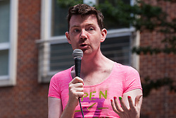 London, UK. 29 July, 2019. A speaker from Lesbians and Gays Support the Migrants addresses activists from Reclaim the Power, All African Women's Group, Docs Not Cops, Lesbians and Gays Support the Migrants and other groups at a protest outside the Home Office to demand an end to the Government's 'hostile environment' policies.