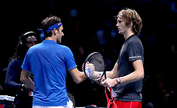 Roger Federer (left) shakes hands with Alexander Zverev after their match during day seven of the Nitto ATP Finals at The O2 Arena, London.