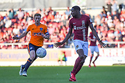 Northampton Town defender Leon Barnett (5) looks for options during the EFL Sky Bet League 1 match between Northampton Town and Oldham Athletic at Sixfields Stadium, Northampton, England on 5 May 2018. Picture by Dennis Goodwin.