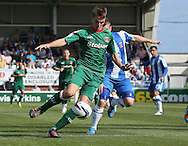 Picture by Paul  Gaythorpe/Focus Images Ltd +447771 871632.08/09/2012.James Berrett of Carlisle United and Jonathan Franks of Hartlepool United during the npower League 1 match at Victoria Park, Hartlepool.