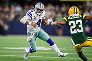 ARLINGTON, TX - OCTOBER 6:  Dak Prescott #4 of the Dallas Cowboys runs the ball and is hit by Jaire Alexander #23 of the Green Bay Packers at AT&T Stadium on October 6, 2019 in Arlington, Texas.  The Packers defeated the Cowboys 34-24.  (Photo by Wesley Hitt/Getty Images) *** Local Caption *** Dak Prescott; Jaire Alexander