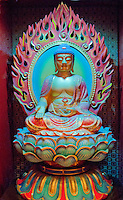 A beautiful rainbow colored Buddha figure at a temple in Singapore, Asia.
