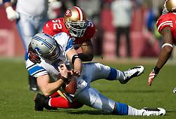 Dec 27, 2009; San Francisco, CA, USA;  San Francisco 49ers linebacker Patrick Willis (52) tackles Detroit Lions quarterback Drew Stanton (5) during the first quarter at Candlestick Park. San Francisco defeated Detroit 20-6.