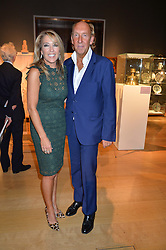 VISCOUNT & VISCOUNTESS DAVENTRY at a party to celebrate the publication of Capability Brown & Belvoir - Discovering a lost Landscape by The Duchess of Rutland, held at Christie's, 8 King Street, St.James, London on 7th October 2015.
