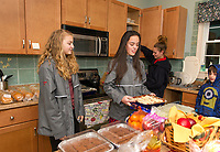 Katie Allen, Lydia Tucker, Danielle and Levi work together to serve dinner made by students from the LHS Key Club at the Belknap House on Wednesday evening.  (Karen Bobotas/for the Laconia Daily Sun)