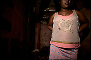 "Sennait, 21 years old, waits customers in her shack. Forced by the need as a sex worker, she would want a different life. Sold in marriage at the age of 8 years to a man, manages to escape from him who abused her. The girls who are forced to marry face a number of problems, and often suffer health problems as a result of having sexual relations from an early age. These girls are being violated physically and emotionally. Child marriage was a major issue raised by the 2007 United Nations Commission on the Status of Women. A U.S. resolution to reduce the practice was passed, encouraging countries to take actions. In Ethiopia the legal age to get married is 18, the law quite often is ignored. Addis Ababa, Ethiopia, on thursday, Febrary 19 2009.....In a tangled mingling of tradition and culture, in the normal place of living, in a laid-back attitude. The background of Ethiopia's ""child brides"", a country which has the distinction of having highest percentage in the practice of early marriages despite having a law that establishes 18 years as minimum age to get married. Celebrations that last days, their minds clouded by girls cups of tella and the unknown for the future. White bridal veil frame their faces expressive of small defenseless creatures, who at the age ranging from three to twelve years shall be given to young brides men adults already...To protect the identities of the recorded subjects names and specific places are fictional."