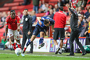 Charlton Athletic forward Jonathan Leko (14) and Nottingham Forest defender Jack Robinson (18) battle for the ball as Charlton Athletic manager Lee Bowyer protests during the EFL Sky Bet Championship match between Charlton Athletic and Nottingham Forest at The Valley, London, England on 21 August 2019.