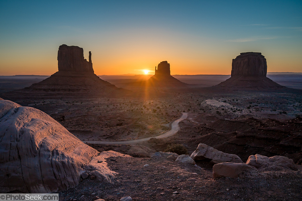 West & East Mittens and Merrick Butte at sunrise in Monument Valley Navajo Tribal Park, Arizona, USA. The Western movie director John Ford set several popular films here.