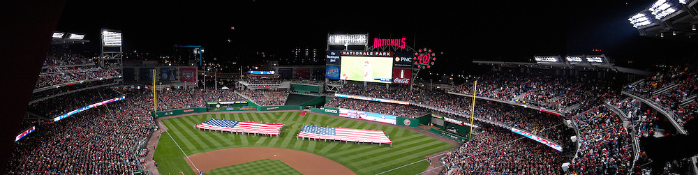 30 March, 2008:  A panoramic view of the new Nationals Park with two American flags spread out in centerfield at the start of the game between the Atlanta Braves and the Washington Nationals on opening day in Washington, D.C.