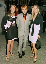 Left to right, MISS TARA PALMER-TOMKINSON family friend of Prince Charles, MR NICK RHODES the musician and MISS MADELEINE FARLEY,  at a party in London on 13th May 1997.LYG 67