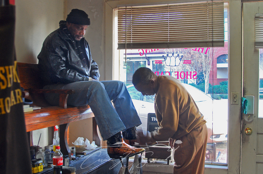 Larry Franklin watches as Ernest Robinson shines his snakeskin boots at The Shine King in Meridian, Miss. on Jan. 11, 2011. King learned to shine shoes as a teenager while working at a newsstand in downtown Meridian. (Photo by Carmen K. Sisson/Cloudybright)