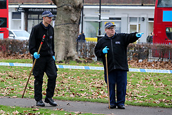 © Licensed to London News Pictures. 28/12/2018. London, UK.  Police Officers search a park opposite Turnpike Lane tube station for clues. A London bus driver was injured after gunshots were fired outside a Turnpike Lane tube station in North London. The 221 bus driver, aged in his 50s, suffered a cut to his forehead from flying glass just after midnight.  Photo credit: Dinendra Haria/LNP