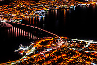 A high angle view looking down from the Fjellheisen aerial tramway to the Tromsø Bridge (Norwegian: Tromsøbrua) is a cantilever road bridge in the city of Tromsø which is located in Tromsø Municipality in Troms county, Norway. It crosses the Tromsøysundet strait between Tromsdalen on the mainland and the island of Tromsøya. Tromso, Norway.