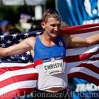 Nick Christie holds an American flag after finishing third in the mens Olympic Trials 20K race walk in Salem, Ore., on Thursday  June 30, 2016.