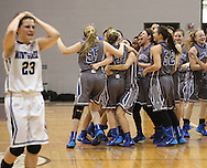 The Georgetown Lady Eagles celebrate their 53-43 victory over Montgomery as Montgomery's Rina Rraci, left, walks past in defeat in the Class 4A Region 3 Final girls high school basketball game, Saturday, February 22, 2014, at Campbell Center in Houston.