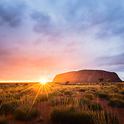 Sunrise at Uluru with dramatic clouds