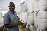 Moses Coker (District logistics officer Bombali District Medical stores) checks in on the supplies such as Malaria Medication, Antibiotics, mattresses and blankets that were just brought into the newly finished storage building in Makeni, Sierra Leone (July 18th, 2016).<br /> <br /> This project for the Rehabilitation and Extension of District Medial Stores Masuba was supported by UNICEF and funded by the European Union for the Ministry of Health and Sanitation.<br /> <br /> The MDG Initiative in Sierra Leone - Bridging the gaps to attain MDG 4 and 5:<br /> The desired impact of the program is to contribute to the reduction of the mortality and morbidity of children under 5, infants, newborn and pregnant women in the next three years.