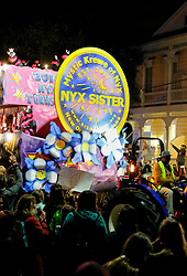 03 February 2016. New Orleans, Louisiana.<br /> Mardi Gras. The all female Mystic Krewe of Nyx parades along Magazine Street with brightly decorated floats, marching bands and dance troupes.<br /> Photo&copy;; Charlie Varley/varleypix.com