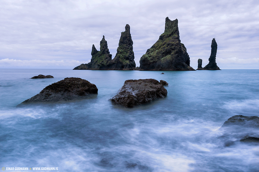 Reynisdrangar are basalt sea stacks situated under the mountain Reynisfjall near the village Vík í Mýrdal, southern Iceland which is framed by a black sand beach that was ranked in 1991 as one of the ten most beautiful non-tropical beaches in the world.
