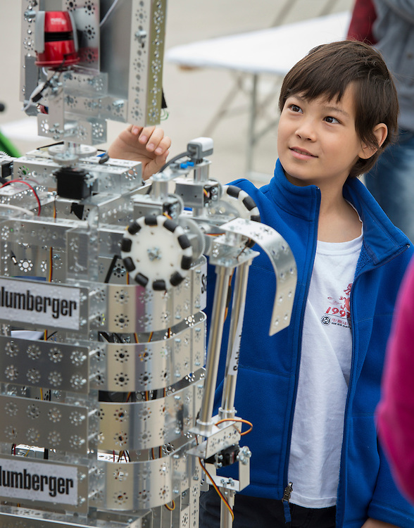 A students checks out one of Young Men's College Preparatory Academy's robots at the When I Grow Up fair, March 8, 2014.