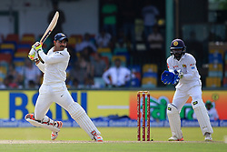 August 4, 2017 - Colombo, Sri Lanka - Indian cricketer Ravindra Jadeja(L) plays a shot as Sri Lankan wicket keeper Niroshan Dickwella looks on during the 2nd Day's play in the 2nd Test match between Sri Lanka and India at the SSC international cricket stadium at the capital city of Colombo, Sri Lanka on Friday 04 August 2017. (Credit Image: © Tharaka Basnayaka/NurPhoto via ZUMA Press)