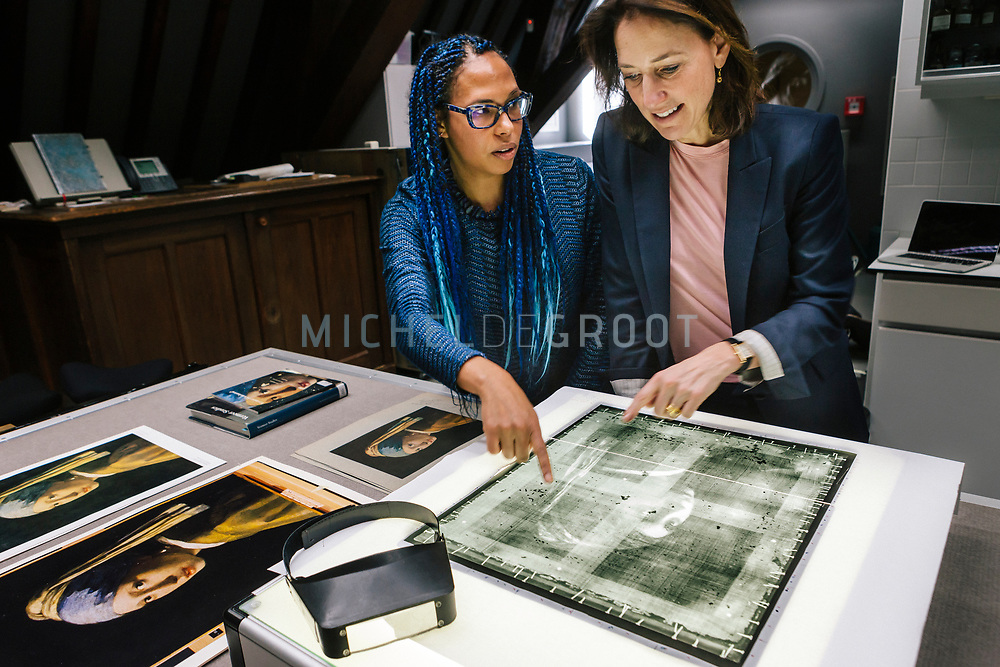 Paintings Conservator Abbie Vandivere (left) and Museum Director Emilie Gordenker (right) examining an X-ray photo of the iconic Johannes Vermeer painting &quot;Girl with the Pearl Earring&rdquo; at the Mauritshuis museum in The Hague, the Netherlands on February 15, 2018<br />