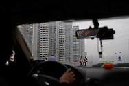A couple walks along a street lined with apartment buildings, seen through the window of a taxi cab, in Chongqing, China, Friday, Oct. 31, 2008. Block after city block, towers of concrete, steel and glass fill the skyline. Teeming and congested, the intensely urban landscapes of China's biggest cities show a glimpse of what the future will hold for the rest of the country.In the sprawling megacities of Beijing, Shanghai and Chongqing, where populations exceed 10 million people, extreme urban density means that the number of people living within a few square blocks here is equal to the population of entire mid-size U.S. cities. .China's urban population soared to 607 million people last year _ nearly equaling the 700 million living in the countryside. The country's headlong plunge toward urbanization continues unabated as tens of millions of migrants from the countryside flood to cities in search of money, jobs and other opportunities.