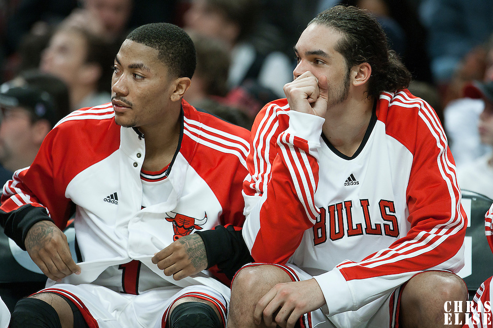 21 December 2009: Chicago Bulls center Joakim Noah rests next to Derrick Rose during the Sacramento Kings 102-98 victory over the Chicago Bulls at the United Center, in Chicago, Illinois, USA.