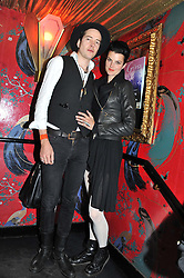 KARIN PARK and KJETIL NERNES at the JW Anderson Top Shop Party held at Madame Jojo's, 8-10 Brewer Street, London W1 on 17th September 2012.