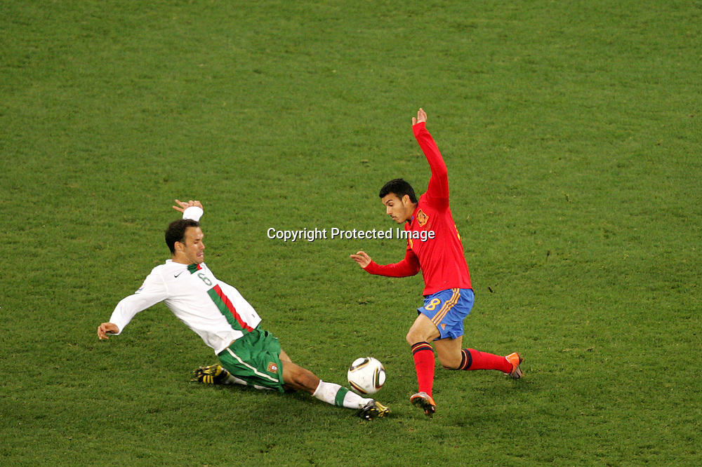 Ricardo Carvalho of Portugal and Pedro of Spain  during the FIFA World Cup 2010 last 16 match between Spain and Portugal held at The Cape Town Stadium in Green Point, Cape Town, South Africa on the 29th June 2010<br /> <br /> <br /> Photo by Ron Gaunt/SPORTZPICS