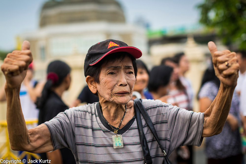 26 MAY 2014 - BANGKOK, THAILAND:  A woman protests against the coup in Thailand at Victory Monument during a pro-democracy rally in Bangkok. About two thousand people protested against the coup in Bangkok. It was the third straight day of large pro-democracy rallies in the Thai capital as the army continued to tighten its grip on Thai life.  PHOTO BY JACK KURTZ