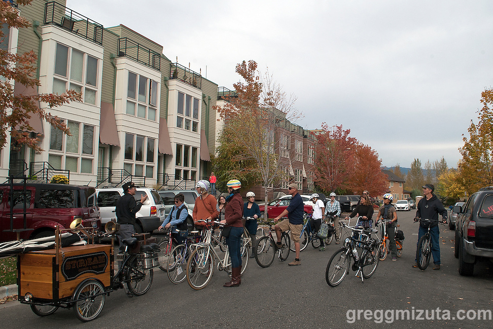 Jodi Eichelberger, in front of artist Sam Paden's live/work studio, explains to the ST(r)EAM Bike/Art tour group how the Surel Mitchell Live-Work-Create District in Garden City, Idaho was created. The group visited several artists at their studios on October 24, 2015. <br /> <br /> Artists and venues on the tour included landscape designer/artist Steven Gossett (Gossett Landscape and Design), jeweler Angela Sebolt (La De Da Jewelry), textile artist Arin Arthur (Arin Arthur Textiles), metal artists Rick and Kath Sanders (Firefly Garden Art), fine art photographer James Talbot, Cinder Winery and an &quot;outside looking in&quot; view of Matt Grover's River Waves kinetic installation.