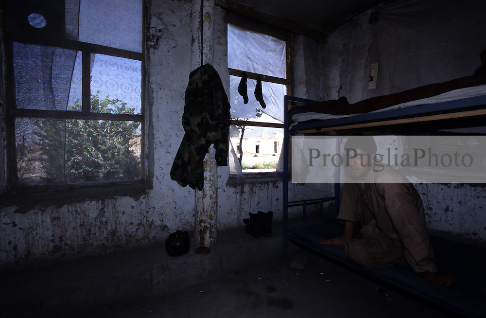 Kabul, 25 July 2005.Portrait of an Afghan soldier in his bedroom.