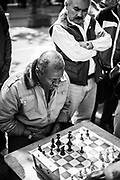 A chess player contemplates his next move in a street match in Bogotá