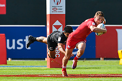 Cooper Coats of Canada evades the tackle of Dylan Collier of New Zealand <br /> <br /> Photographer Craig Thomas/Replay Images<br /> <br /> World Rugby HSBC World Sevens Series - Day 2 - Friday 6rd December 2019 - Sevens Stadium - Dubai<br /> <br /> World Copyright © Replay Images . All rights reserved. info@replayimages.co.uk - http://replayimages.co.uk