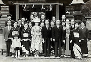 group wedding photo infront of shrine Japan 1950s