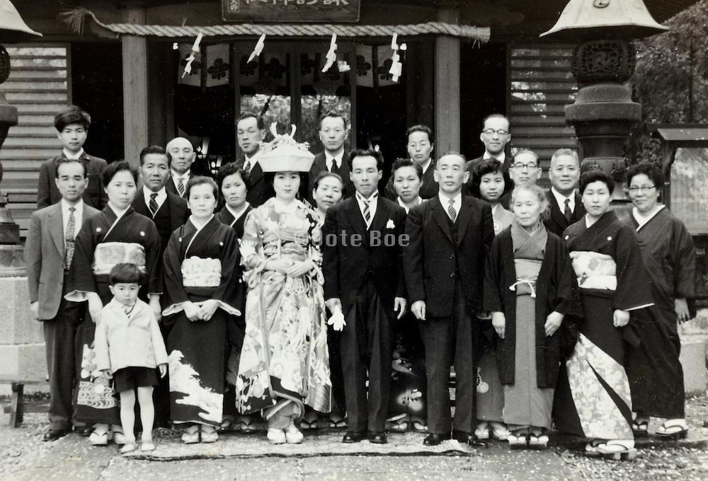 group wedding photo infront of shrine Japan 1950s