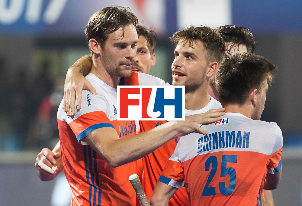 BHUBANESWAR - Mirco Pruijser (Ned) heeft gescoord   tijdens de Hockey World League Final wedstrijd Nederland-Argentinie (3-3). rechts Tristan Algera (Ned)  en Thierry Brinkman (Ned)  COPYRIGHT  KOEN SUYK