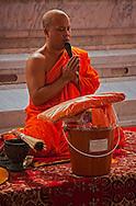 Buddhist monk praying at Big Buddha Temple in Bangkok, Thailand.