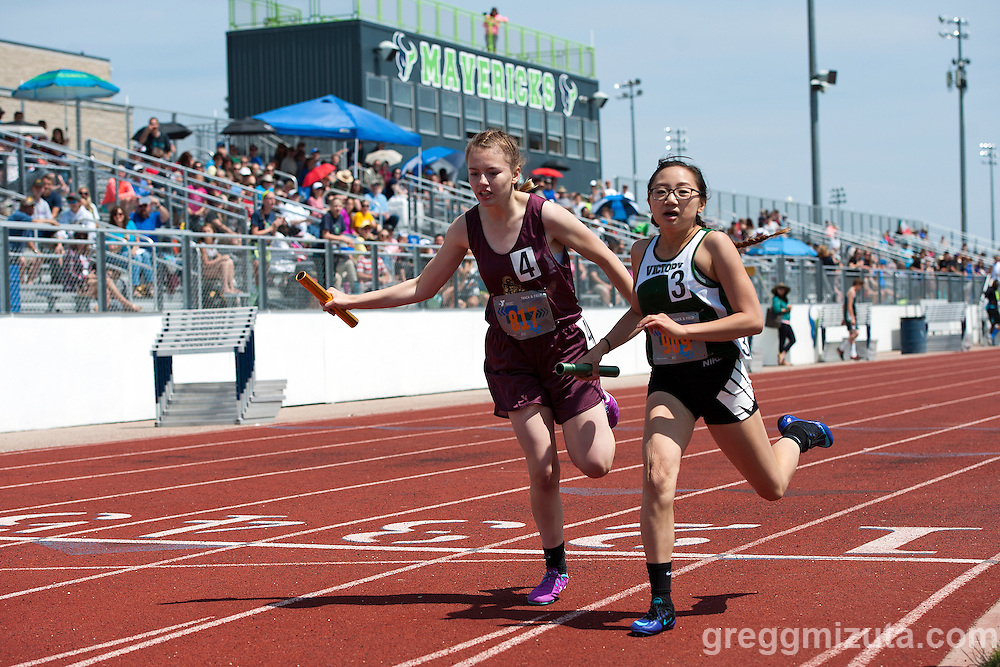 Rigby's Camryn Williams and Victory Charter's Amanda Lee at the finish of the YMCA Track &amp; Field Middle School Invitational sprint medley relay (100-100-200-400m) on May 28, 2016 at Mountain View High School, Meridian, Idaho.<br /> <br /> Victory Charter finished first (2:06.40), followed by Rigby (2:06.47), Sage Valley (2:08.89), and Rockland (2:13.74).