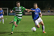 Ben Middleton (Captain) (North Ferriby United) and Liam Ridehalgh (Tranmere Rovers) go for the ball during the Vanarama National League match between North Ferriby United and Tranmere Rovers at Eon Visual Media Stadium, North Ferriby, United Kingdom on 21 March 2017. Photo by Mark P Doherty.